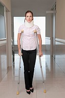 Patient walking with the help of crutches