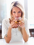 Woman drinking an alcoholic beverage