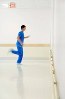 Doctor running in a hospital corridor