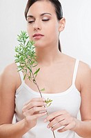 Close_up of a woman smelling aroma herbs