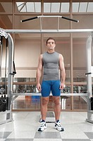 Man standing in a gym