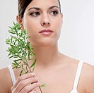 Close_up of a woman holding aroma herbs
