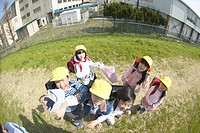 Portrait of school children at riverbank, fish_eye lens
