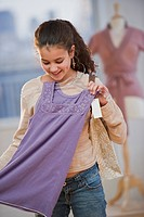 Young girl shopping for clothing