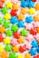 Star shaped colorful candies, close up, white background, full frame