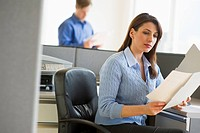 Woman working in cubicle