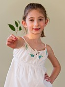 Young girl holding green leaves