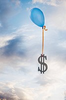 Balloon tied to a dollar symbol