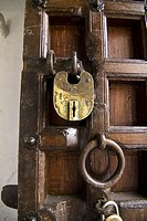 Lock on wooden door, City Palace, Udaipur, India