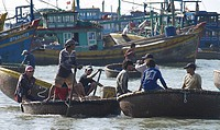 Fishermen and basket boats in Mui Ne