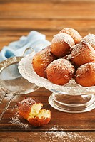 Doughnuts with icing sugar on cake stand
