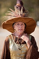 Gainesville FL - January 2009 - Senior woman dressed in period clothing as a witch at Hoggetowne Medieval Faire in Gainesville, Florida