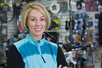 Mature woman stands in bike shop