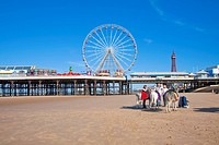 England, Lancashire, Blackpool. Donkey rides on the beach at Blackpool by Central Pier.