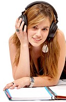 college student listening to music while studying isolated over a white background