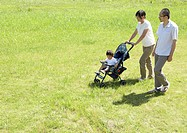 Parents and child walking in park