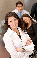Business woman portrait and her team behind