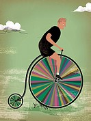 A man riding a rainbow colored penny farther (thumbnail)