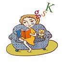 A young girl reading in a comfy arm chair (thumbnail)