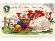 A vintage Easter postcard of lilies, a white rabbit and Easter eggs