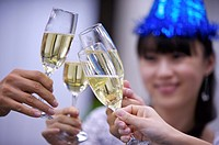 People holding glasses of champagne to toast together