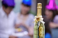 Close_up of a bottle of champagne with bow
