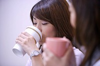 Young women drinking coffee for a rest together (thumbnail)