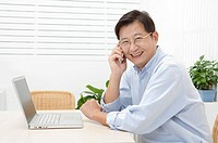 Husband, Man using mobile phone and smiling at the camera