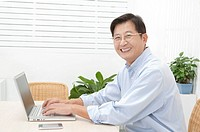 Husband, Man using laptop and smiling at the camera