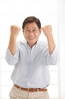 Husband, Man standing with fists up and smiling with confidence