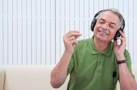 Domestic Life, a senior man listening to music with eyes closed and smiling