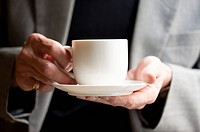 Domestic Life, Close_up of human hands holding a cup and saucer