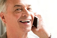 Domestic Life, Close_up of a senior man on the phone and laughing