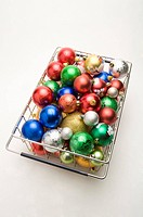 A basket of colorful Christmas baubles