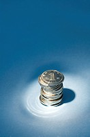 Chinese Currency, stack of coins under spotlight