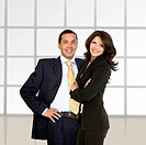 beautiful business couple at an office smiling