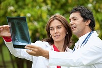 male and female doctors watching an x_ray outdoors