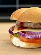 A freshly made American style hamburger with sauce