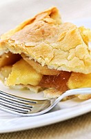 Slice of fresh apple pie on a plate