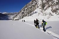 scuba diver walking on a frozen lake, Blindsee, Austria