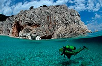 scuba diver and coast split image, Medterranean Sea Sardinia, Italy