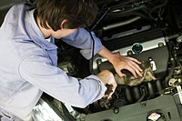 Mechanic repairing car engine (thumbnail)