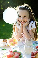 Girl smiling happily at birthday party (thumbnail)