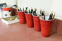 Artists drawing pencils organized in cups