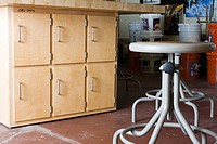 Cabinets and stools in workshop
