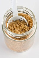 Whole wheat vermicelli in jar with scoop