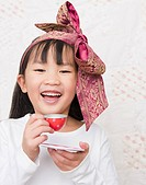 Chinese girl having tea party