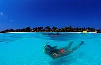 Snorkeling woman near maldives island Kuredu, Indian Ocean Lhaviyani Atoll Kuredu, Maldives Island