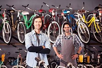 Bike shop owners standing in store
