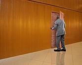 African American businessman opening door to nowhere